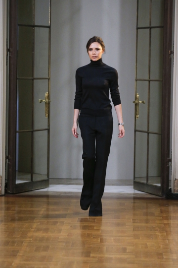 In this photo provided by Victoria Beckham, Victoria Beckham comes onto the runway to greet guests after her collection was modeled during Fashion Week in New York, Sunday Feb. 11, 2018. (Courtesy of Victoria Beckham via AP)