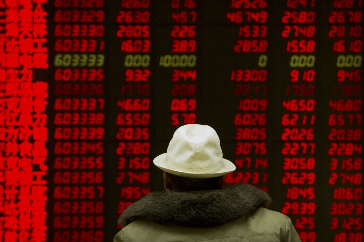 A Chinese investor monitors stock prices at a brokerage house in Beijing, Monday, Feb. 12, 2018. Asian stock markets are mostly higher after Wall Street gained following a week of history-making losses. (AP Photo/Mark Schiefelbein)