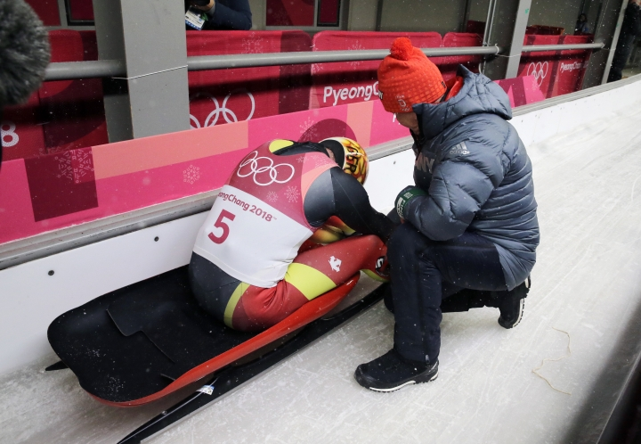 Felix Loch of Germany sits dejected in the finish area after losing his lead on the final run during the men's luge competition at the 2018 Winter Olympics in Pyeongchang, South Korea, Sunday, Feb. 11, 2018.(AP Photo/Andy Wong)