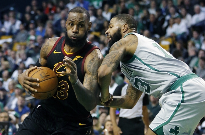 Cleveland Cavaliers' LeBron James (23) drives past Boston Celtics' Marcus Morris (13) during the third quarter of an NBA basketball game in Boston, Sunday, Feb. 11, 2018. The Cavaliers won 121-99. (AP Photo/Michael Dwyer)