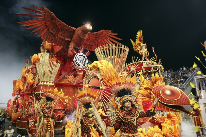 Dancers from the Gavioes da Fiel samba school perform during a carnival parade in Sao Paulo, Brazil, Sunday, Feb. 11, 2018. (AP Photo/Andre Penner)