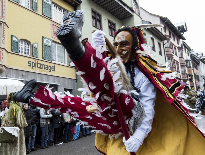 A so-called Federahannes, a carnivalist of the tradiotal Swabian carnival, jumps with a stick during a parade in Rottweil, southwestern Germany, on Shrove Monday, Feb. 12, 2018. (Patrick Seeger/dpa via AP)