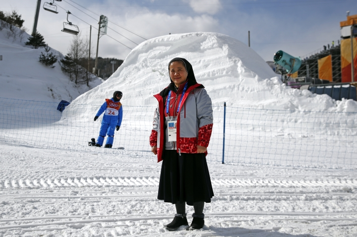 "In this Feb. 12, 2018 photo, Sungsook Kim, a Catholic nun who goes by her religious name, Sister Droste, poses for a photograph at Phoenix Snow Park during the 2018 Winter Olympics in Pyeongchang, South Korea. Droste runs several centers spread across the sprawling Olympics venues to help sexual assault victims during the Winter Games. ""I am praying to God that nothing happens,"" she says. ""But we are here."" (AP Photo/Patrick Semansky)"