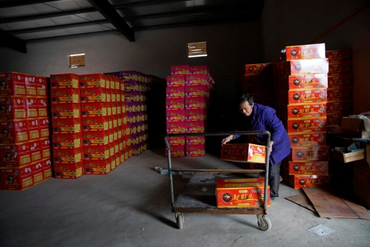 A worker carries pyrotechnic product at Liuyang Standard Fireworks Manufactory in Liuyang, Hunan province, China January 29, 2018, Picture taken January 29, 2018. REUTERS/Aly Song