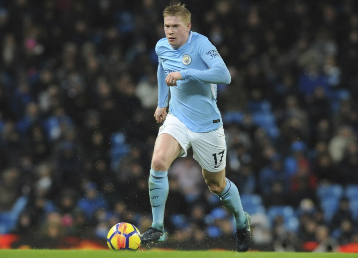 FILE - This is a Tuesday, Jan. 2, 2018 file photo of Manchester City's Kevin De Bruyne in action during the English Premier League soccer match between Manchester City and Watford at Etihad stadium, in Manchester, England. Kevin De Bruyne is in such good form this season that Manchester City manager Pep Guardiola believes the midfielder could become the world player of the year. It is quite a comment from Guardiola, who usually dismisses any comparisons with Lionel Messi and has previously said De Bruyne is on a separate table to the Barcelona star. Guardiola says De Bruyne has to capture the Champions League to win the Ballon d'Or. City plays Basel in the first leg of the last 16 on Tuesday Feb. 13, 2018. (AP Photo/Rui Vieira, File)