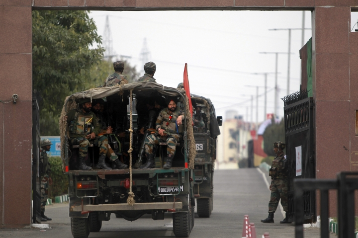 Indian Army soldiers arrive to take position at an Army camp in Jammu, India, Sunday, Feb. 11, 2018. At least two soldiers were killed and three others wounded in Indian-controlled Kashmir on Saturday as soldiers traded fire with armed militants who were holed up inside an army camp, officials said. (AP Photo/Channi Anand)
