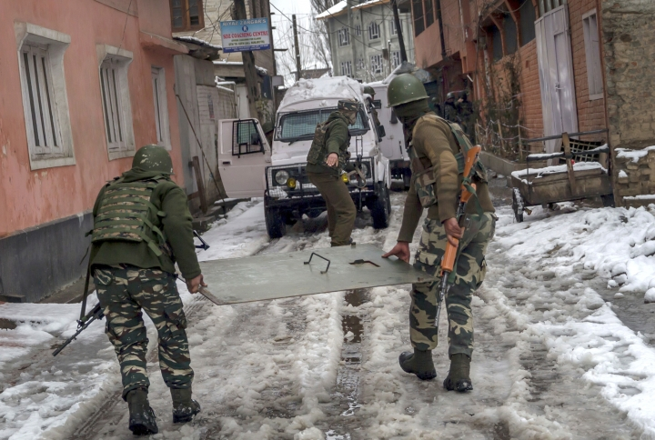 Indian paramilitary force soldiers take position at the site of a gunbattle with armed militants in Srinagar, Indian controlled Kashmir, Monday, Feb. 12, 2018. Two gunmen have opened fire near a paramilitary camp in the main city of Indian controlled Kashmir killing at least one soldier. The attack comes hours after government troops ended a two day gunbattle with three armed gunmen at an army camp in another part of the disputed region. (AP Photo/Dar Yasin)