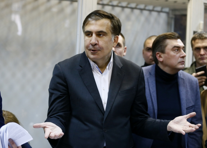 FILE - This is a Monday, Dec. 11, 2017 file photo of former Georgian President Mikheil Saakashvili as he gestures during a hearing in a court room in Kiev, Ukraine. Allies of Mikheil Saakashvili, the former Georgian president-turned opposition leader in Ukraine, say he was detained by masked men who they think acted on behalf of Ukrainian authorities. Saakashvili's ally Liza Bogutskaya said on Facebook that Saakashvili was taken on Monday Feb. 12, 2018 and is being driven to the airport in the capital, Kiev. Other allies say authorities may try to deport him to Poland. (AP Photo/Efrem Lukatsky/File)