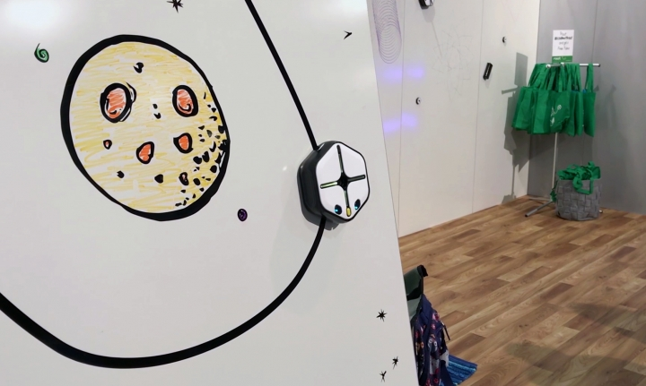 In this Jan. 9, 2018, image made from a video, the Root robot traces a line down a wall using its magnetic treads at the CES gadget show in Las Vegas. Root draws, moves, sees and reacts to touch and various other commands. Kids can use Root to start drawing lines and progress to creating snowflake-like mathematical patterns called fractals. (AP Photo/Ryan Nakashima)