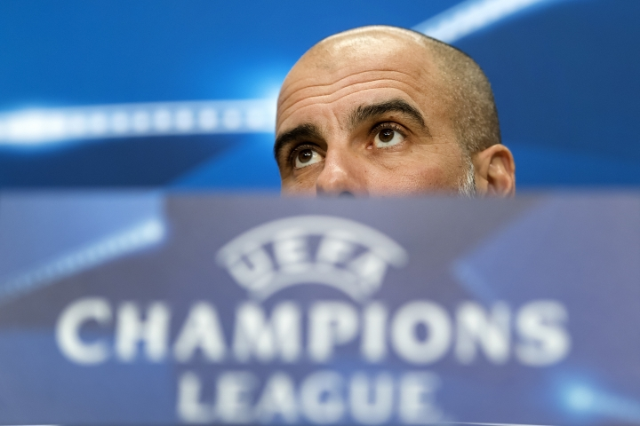 Manchester City's head coach Pep Guardiola attends a media conference about their upcoming UEFA Champions League round of sixteen first leg soccer match between Switzerland's FC Basel 1893 and England's Manchester City, at the St. Jakob-Park stadium in Basel, Switzerland, on Monday, Feb. 12, 2018. (Georgios Kefalas/Keystone via AP)
