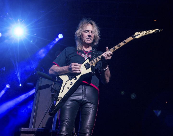 "FILE- In this Oct. 24, 2015 file photo, Glenn Tipton of Judas Priest performs at the 2015 Knotfest USA in San Bernardino, Calif. Tipton is stepping down from touring due to Parkinson's disease, a condition that began to afflict him a decade ago. He will be replaced on the band's ""Firepower"" tour by Andy Sneap, a veteran heavy metal producer, and the guitarist for the British band Hell. (Photo by Paul A. Hebert/Invision/AP, File)"