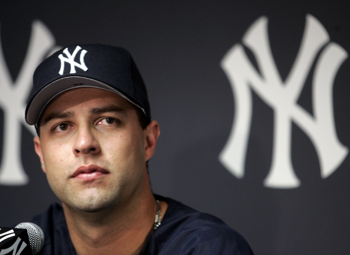 FILE - In this Aug. 1, 2004, file photo, New York Yankees pitcher Esteban Loaiza talks to reporters during a news conference at Yankee Stadium in New York. Former Major League Baseball pitcher Esteban Loaiza has been arrested in California on suspicion of smuggling cocaine and heroin. The San Diego County Sheriff's Department says Loaiza was booked into jail Friday, Feb. 9, 2018, evening and held in lieu of $200,000 bail.(AP Photo/Ed Betz)