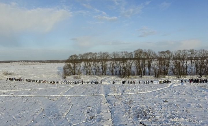 In this photo provided by the Russian Emergency Situations Ministry, RMES employees and Russian police officers work at the scene of a AN-148 plane crash in Stepanovskoye village, about 40 kilometers (25 miles) from the Domodedovo airport, Russia, Monday, Feb. 12, 2018. A Russian passenger plane carrying 71 people crashed Sunday near Moscow, killing everyone aboard shortly after the jet took off from one of the city's airports. The Saratov Airlines regional jet disappeared from radar screens a few minutes after departing from Domodedovo Airport en route to Orsk, a city some 1,500 kilometers (1,000 miles) southeast of Moscow. (Russian Ministry for Emergency Situations photo via AP)