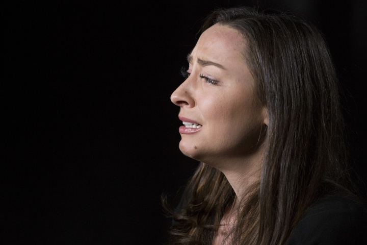 """Former Olympic swimmer Ariana Kukors cries during an interview, Monday, Feb. 12, 2018 in New York. Kukors says her former coach, Sean Hutchison, """"stole so much"""" from her in the decade she alleges he sexually abused her starting when she was a minor. Hutchison has denied the allegations, saying that they were in a consensual relationship after 2012 Olympics, when she was 23. (AP Photo/Mark Lennihan)"""