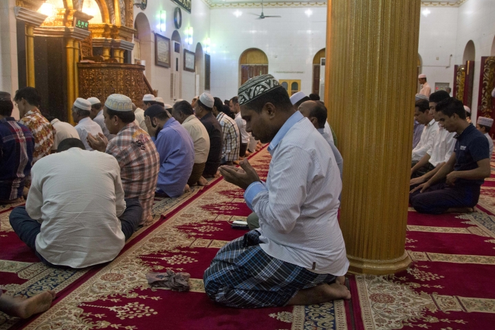 In this Jan. 29, 2018, photo, Myanmar Muslim men pray at a mosque in Yangon, Myanmar. Far from the violence and vengeance unfolding in Myanmar's far west, Rohingya Muslims who once felt relatively safe in Yangon describe a sense of rising persecution and hatred, of vanishing freedoms and opportunities, of Buddhist neighbors and friends who are suddenly much more willing to voice sympathies with the military's campaign in Rakhine state. (AP Photo/Thein Zaw)