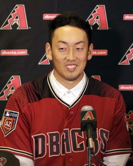 Arizona Diamondbacks pitcher Yoshihisa Hirano, of Japan, speaks with the media during an introductory press conference, Monday, Feb. 12, 2018, in Scottsdale, Ariz. (AP Photo/Rick Scuteri)