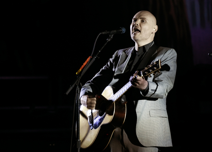 FILE - In this Saturday, March 26, 2017 file photo, Billy Corgan of the Smashing Pumpkins performs at The Theatre at Ace Hotel in Los Angeles. A Smashing Pumpkins representative said Monday, Feb. 12, 2018, that the band has tried to include ex-bassist D'arcy Wretzky in its upcoming reunion, although she says frontman Corgan invited her to re-join the group but then rescinded the offer. (Photo by Chris Pizzello/Invision/AP, File)