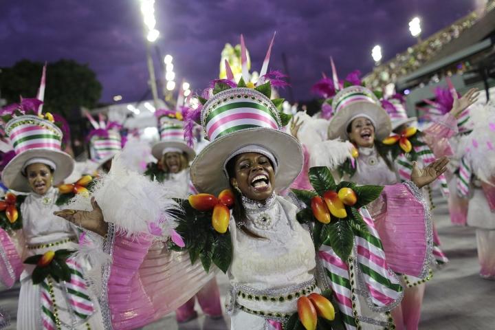 Performers from the Mocidade samba school parade during Carnival celebrations at the Sambadrome in Rio de Janeiro, Brazil, Monday, Feb. 12, 2018. (AP Photo/Silvia Izquierdo)