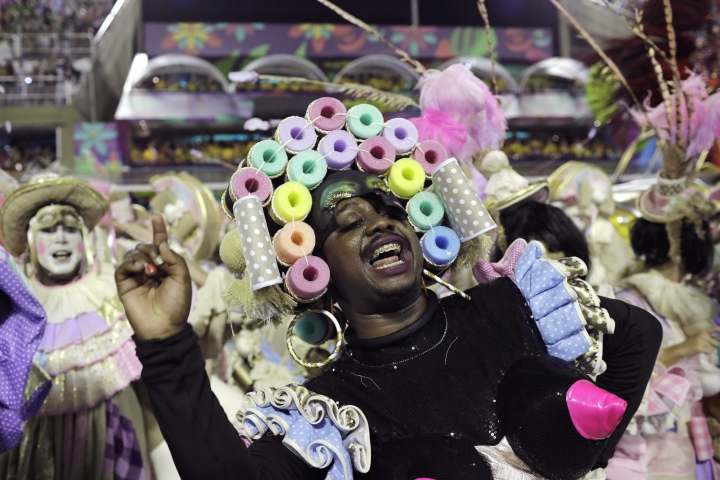 A performer from Mangueira samba school parades during Carnival celebrations at the Sambadrome in Rio de Janeiro, Brazil, Monday, Feb. 12, 2018. (AP Photo/Leo Correa)