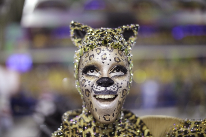 A performer from Mangueira samba school parades during Carnival celebrations at the Sambadrome in Rio de Janeiro, Brazil, Monday, Feb. 12, 2018. (AP Photo/Leo Correa)