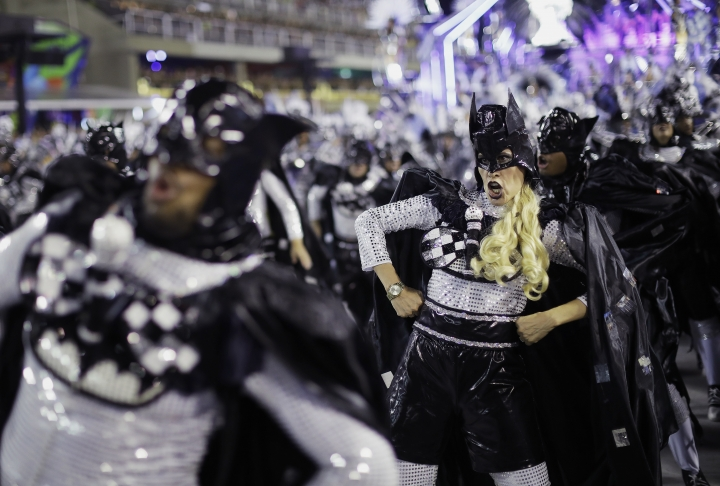 Performers from Academicos do Grande Rio samba school parade during Carnival celebrations at the Sambadrome in Rio de Janeiro, Brazil, Monday, Feb. 12, 2018. (AP Photo/Leo Correa)
