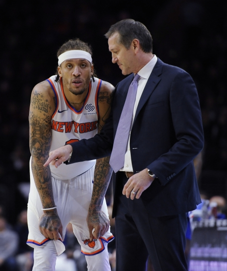 New York Knicks head coach Jeff Hornacek talks to Michael Beasley (8) in the first half of an NBA basketball game against the Philadelphia 76ers, Monday, Feb 12, 2018, in Philadelphia. (AP Photo/Michael Perez)
