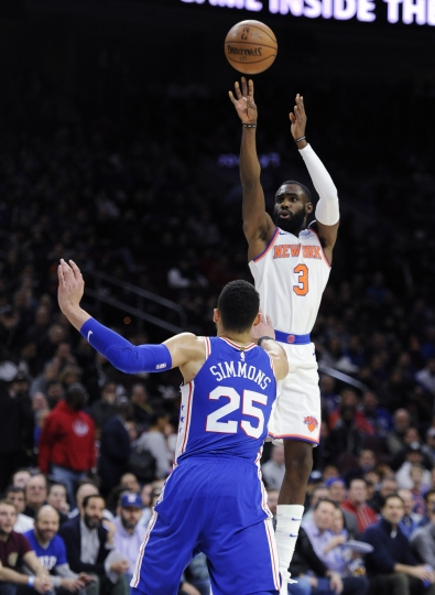 New York Knicks' Tim Hardaway Jr. (3) takes a jump shot over Philadelphia 76ers' Ben Simmons (25) in the first half of an NBA basketball game, Monday, Feb 12, 2018, in Philadelphia. (AP Photo/Michael Perez)