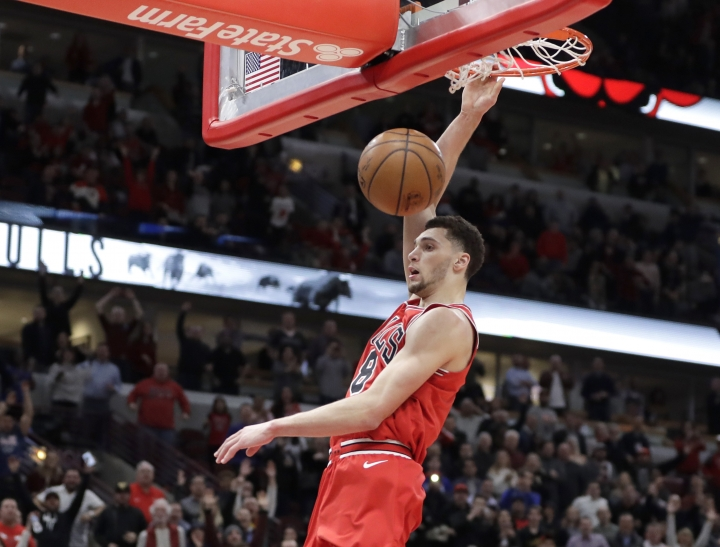 Chicago Bulls' Zach LaVine dunks the ball after stealing a pass intended for Orlando Magic's Shelvin Mack during the second half of an NBA basketball game Monday, Feb. 12, 2018, in Chicago. Bulls won 105-101. (AP Photo/Charles Rex Arbogast)