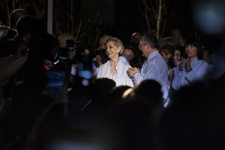 Fashion designer Carolina Herrera acknowledges applause after her fashion show during Fashion Week in New York, Monday, Feb. 12, 2018. (AP Photo/Andres Kudacki)