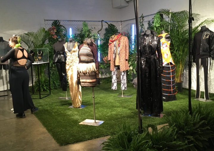 """Fashion from a small collection inspired by the upcoming superhero film """"Black Panther,"""" are displayed in New York on Monday, Feb. 12, 2018. The designs were created by the brands Chromat, Cushnie et Ochs, Fear of God, LaQuan Smith, Ikire Jones, Sophie Theallet and TOME, with capsule collections by jewelry designer Douriean Fletcher and shoe designer Aurora James of Brother Vellies. (AP Photo/Leanne Italie)"""