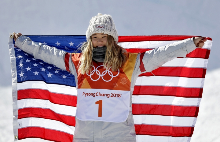 Chloe Kim, of the United States, celebrates winning gold in the women's halfpipe finals at Phoenix Snow Park at the 2018 Winter Olympics in Pyeongchang, South Korea, Tuesday, Feb. 13, 2018. (AP Photo/Gregory Bull)