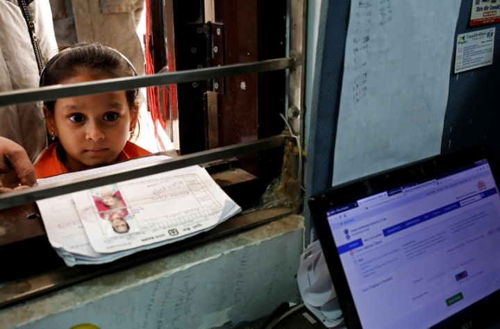 A girl waits for her turn to enrol for the Unique Identification (UID) database system, also known as Aadhaar, at a registration centre in New Delhi, India, January 17, 2018. Picture taken January 17, 2018. REUTERS/Saumya Khandelwal