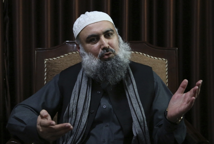 In this Wednesday, Feb. 7, 2018 photo, Agha Jan Motasim, a former senior member of the Taliban leadership shura or council speaks during an interview with the Associated Press in Kabul, Afghanistan. Mohtism, who still counts the radical religious movement's leader Mullah Habaitullah Akhunzada among his friends, warned that Donald Trump's strategy of using the military to force a more compliant Taliban to the negotiation table could lead to more suicide attacks by a Taliban, seeking revenge for U.S. and Afghan government assaults in rural Afghanistan, where they often hold sway. (AP Photo/Rahmat Gul)