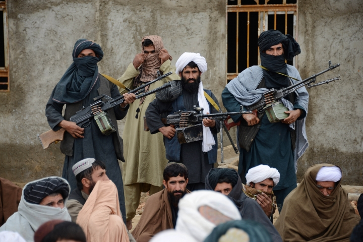 FILE - In this Nov. 3, 2015 file photo, Afghan Taliban fighters listen to Mullah Mohammed Rasool, the newly-elected leader of a breakaway faction of the Taliban, in Farah province, Afghanistan. Despite US President Donald Trump's pronouncement that there would be no talks with the Taliban following a series of deadly attacks in Kabul, officials say talks continue, but neither side trusts the other and neither believes the other negotiates independently.(AP Photo, File)