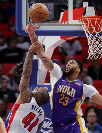 New Orleans Pelicans forward Anthony Davis (23) blocks a Detroit Pistons guard Jameer Nelson (41) shot in the second half of an NBA basketball game in Detroit, Monday, Feb. 12, 2018. (AP Photo/Paul Sancya)
