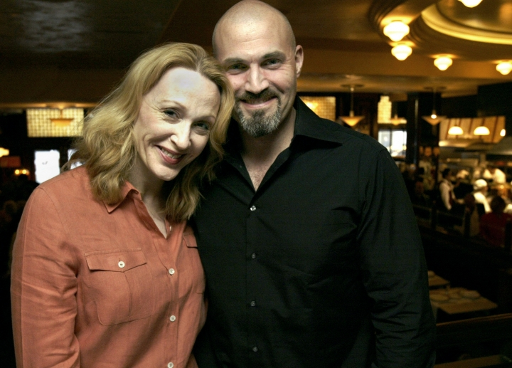 "FILE - In this May 18, 2005, file photo, actors Jan Maxwell and Marc Kudisch pose at a midtown restaurant in New York. The two played the villainous Baroness and Baron Bomburst in the Broadway musical ""Chitty Chitty Bang Bang."" Maxwell's husband, actor and playwright Robert Emmet Lunney, says she died on Sunday, Feb. 11. 2018, following a long battle with cancer. The Broadway star and five-time Tony Award nominee died at her New York home at age 61. (AP Photo/Gregory Bull, File)"