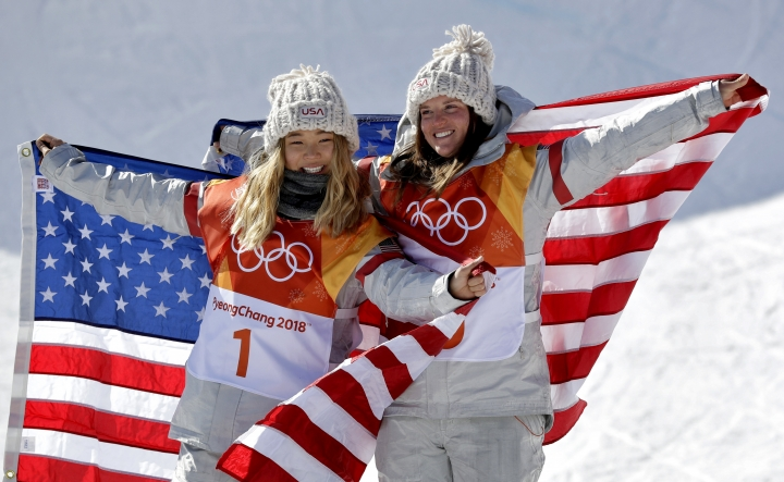 Gold winner Chloe Kim, of the United States, (1) and bronze winner Arielle Gold, of the United States, celebrate after the women's halfpipe finals at Phoenix Snow Park at the 2018 Winter Olympics in Pyeongchang, South Korea, Tuesday, Feb. 13, 2018. (AP Photo/Gregory Bull)