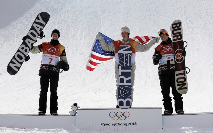 From left: Silver medal winner Max Parrot, of Canada (7), gold medal winner Red Gerard, of the United States (6), and Bronze medal winner Mark McMorris, of Canada, cheer during the medal recognition ceremony after the men's slopestyle final at Phoenix Snow Park at the 2018 Winter Olympics in Pyeongchang, South Korea, Sunday, Feb. 11, 2018. (AP Photo/Lee Jin-man)