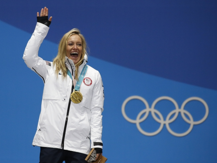 Women's slopestyle gold medalist Jamie Anderson, of the United States, smiles during the medals ceremony at the 2018 Winter Olympics in Pyeongchang, South Korea, Monday, Feb. 12, 2018. (AP Photo/Jae C. Hong)