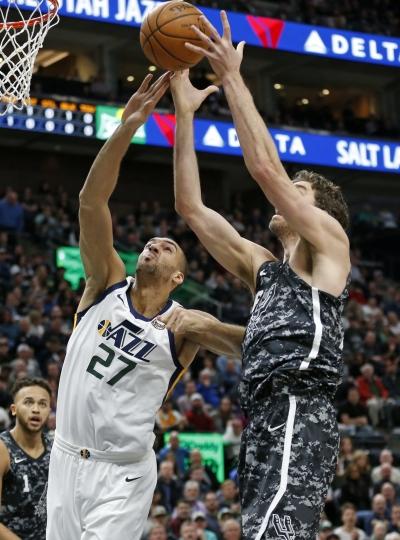 Utah Jazz center Rudy Gobert (27) and San Antonio Spurs center Pau Gasol, right, reach for a rebound in the first half during an NBA basketball game Monday, Feb. 12, 2018, in Salt Lake City. (AP Photo/Rick Bowmer)