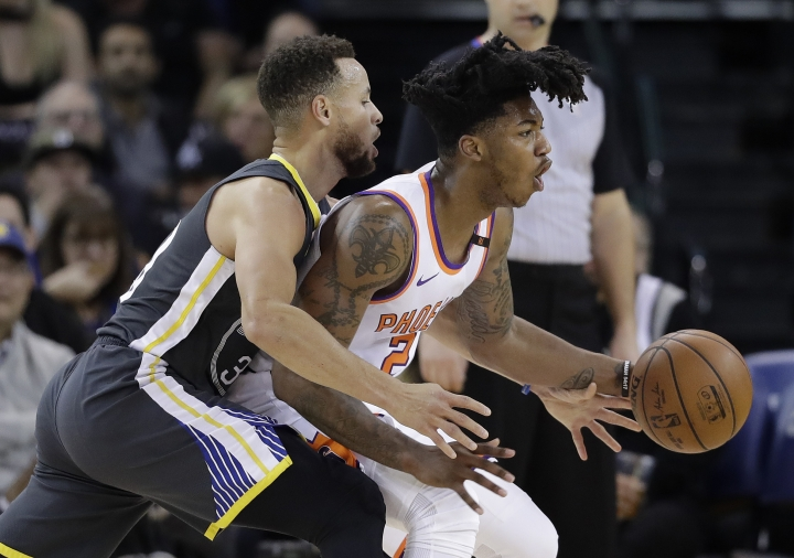 Phoenix Suns' Elfrid Payton, right, is defended by Golden State Warriors' Stephen Curry during the first half of an NBA basketball game Monday, Feb. 12, 2018, in Oakland, Calif. (AP Photo/Marcio Jose Sanchez)