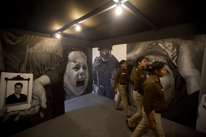 "In this Friday, Feb. 9, 2018, photo, policewomen look at the art project of Subba Ghosh ""THE FLOW"" during India Art in New Delhi, India. Human displacement, the suffering of refugees and the notion of identity dominated the 2018 India Art Fair, an important platform for contemporary artists that provides a carefully curated glimpse into the Asian art scene through the years. (AP Photo/Manish Swarup)"