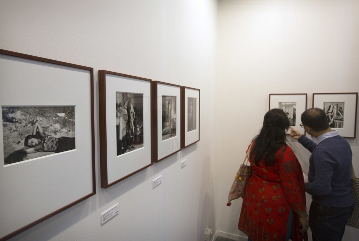 In this Friday, Feb. 9, 2018, photo, a couple looks at the a rare collection of photographs of Amrita Sher-Gil , one of the best known modern artists in India's art history, exhibited by the Sher-Gil Archives during India Art fair, in New Delhi, India. Human displacement, the suffering of refugees and the notion of identity dominated the 2018 India Art Fair, an important platform for contemporary artists that provides a carefully curated glimpse into the Asian art scene through the years. (AP Photo/Manish Swarup)