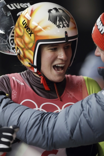 Natalie Geisenberger of Germany celebrates her gold medal win the finish area after the women's luge final at the 2018 Winter Olympics in Pyeongchang, South Korea, Tuesday, Feb. 13, 2018. (AP Photo/Michael Sohn)