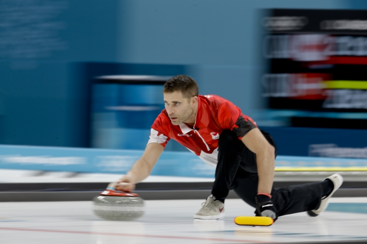 Canada's John Morris throws a stone during the mixed doubles final curling match against Switzerland Jenny Perret and Martin Rios at the 2018 Winter Olympics in Gangneung, South Korea, Tuesday, Feb. 13, 2018. (AP Photo/Natacha Pisarenko)
