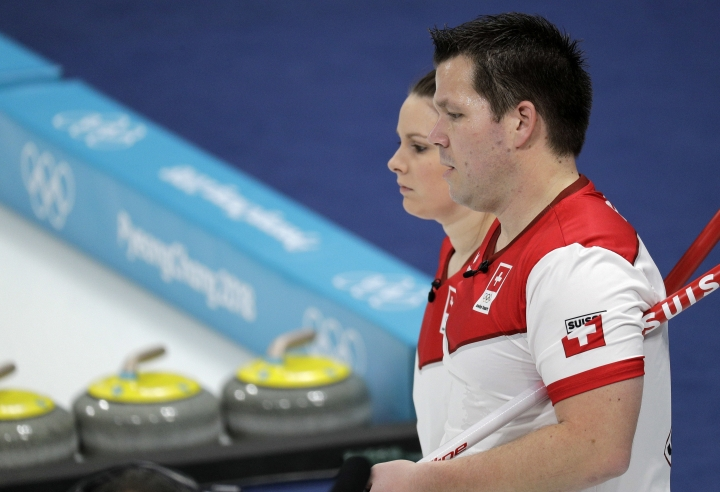Switzerland Jenny Perret and Martin Rios watch during their mixed doubles curling finals match against Canada at the 2018 Winter Olympics in Gangneung, South Korea, Tuesday, Feb. 13, 2018. (AP Photo/Aaron Favila)