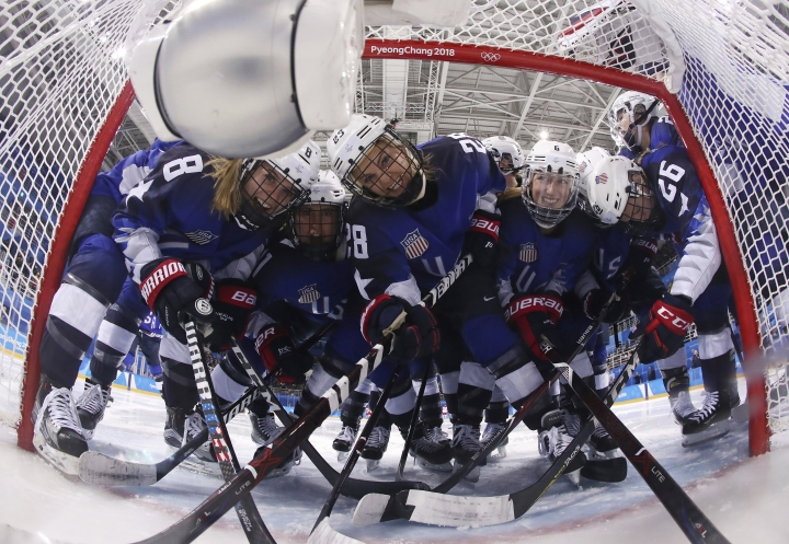 Players from the United States pose for the camera as they gather around the goal before the preliminary round of the women's hockey game against the team from Russia at the 2018 Winter Olympics in Gangneung, South Korea, Tuesday, Feb. 13, 2018. (Bruce Bennett/Pool Photo via AP)