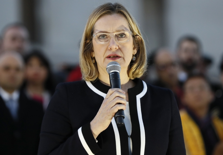 "FILE - This is a Thursday March 23, 2017 file photo of Britain's Home Secretary Amber Rudd speaks during a vigil in Trafalgar Square, London. The British government Tuesday Feb. 13, 2018 is unveiling new technology to remove extremist material from social media. It says that the system uses advanced machine learning to analyze the sound and visual components of videos for ""subtle signals."" That helps it determine whether the content could be Islamic State propaganda. The tool was revealed Tuesday by Home Secretary Amber Rudd and will be presented to tech companies in Silicon Valley. (AP Photo/Kirsty Wigglesworth/file)"