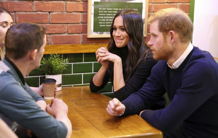 Britain's Prince Harry and Meghan Markle speak with patrons at the Social Bite in Edinburgh, Scotland, Tuesday, Feb. 13, 2018. The recently engaged couple are on a one day tour to Edinburgh, and will visit the Castle and observe the firing of the One O'clock Gun. (Owen Humphreys/Pool Photo via AP)
