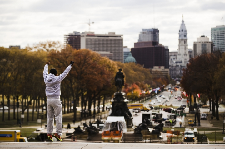"""FILE - In this Nov. 21, 2016, file photo, Alex Carrillo Quito of Ecuador imitates the character Rocky Balboa from the 1976 movie """"Rocky,"""" on the steps of the Philadelphia Museum of Art, in Philadelphia. (AP Photo/Matt Rourke, File)"""